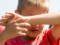 Little young boy kid covering eyes from sunlight. Stock Photography