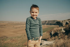 Little young caucasian boy in nature, childhood Royalty Free Stock Photo