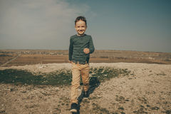 Little young caucasian boy in nature, childhood. In image with copy space Royalty Free Stock Photography