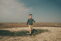 Little young caucasian boy in nature, childhood. In image with copy space Stock Photos