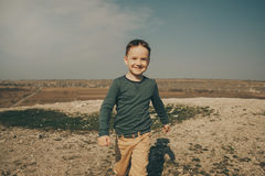 Little young caucasian boy in nature, childhood. In image with copy space Royalty Free Stock Image