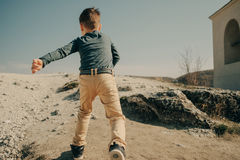 Little young caucasian boy in nature, childhood. In image with copy space Stock Photography