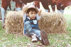 Little  young cowboy laying in the hay Royalty Free Stock Photo