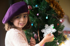 Little young girl decorating christmas tree Royalty Free Stock Image