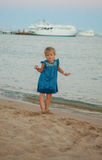 Little young girl posing on sea coast Stock Photos