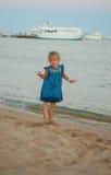 Little young girl posing on sea coast Stock Photos