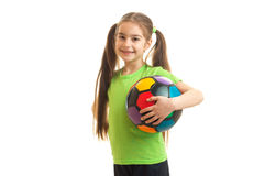 Little young girl with soccer ball in hand smiling on camera Stock Photo