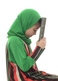 Little Young Muslim Girl Holding Quran Stock Photo