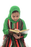 Little Young Muslim Girl Reading Book of Quran Stock Image