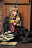 Little Young Witch With Black Cat And Books Stock Images
