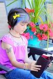 Little yuppie girl reading bible stock photo