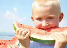 LittleBoy eating watermelon Royalty Free Stock Photos