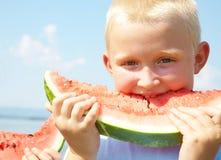 LittleBoy eating watermelon Royalty Free Stock Photos