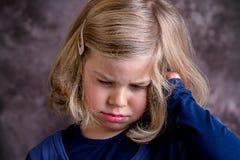 Littlegirl is in bad mood Royalty Free Stock Photos
