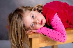 Littlegirl is looking sad Stock Photo