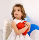 A littlel angel with red heart Royalty Free Stock Photography