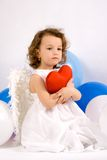 A littlel angel with red heart Stock Photos