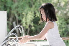 Littlle asian girl washing hand Royalty Free Stock Images