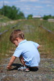 Littlle boy on railroad Royalty Free Stock Photography