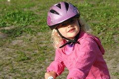 Littlle girl on a bike Stock Photography