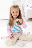 Littlle girl having tea Royalty Free Stock Images