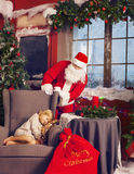 Littlle sleeping girl and Santa Claus looking at her Royalty Free Stock Image