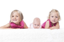 Littls sisters on white Royalty Free Stock Photography