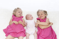 Littls sisters on white Stock Image