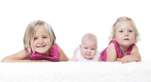 Littls sisters on white Royalty Free Stock Photos