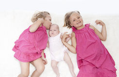Littls sisters on white Royalty Free Stock Photo