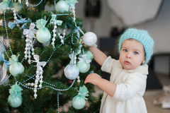 Littlt girl decorating a Christmas tree toys, holiday, gift, decor, new year, christmas, lifestyle Royalty Free Stock Photos