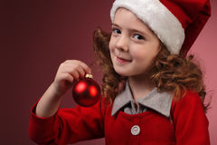 Litttle girl with red christmas ball Royalty Free Stock Photos