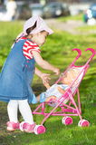 Litttle Mother. Little mother enjoys time outdoor with her doll Stock Photography