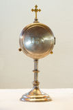 Liturgical vessel gold monstrance. Isolated Stock Images