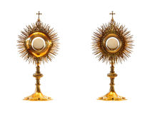 Liturgical vessel gold monstrance. Isolated Stock Photo