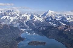 Lituya Bay with mountains. Aerial of Lituya Bay with Mt. Fairweather range in the background on a sunny day Stock Photos