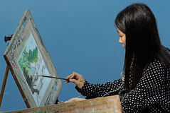 Liujiang China-A girl is drawing Royalty Free Stock Photo