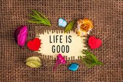 Liv är godan som är skriftlig i hål på säckväven royaltyfri foto