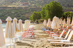 Livadi beach in resort village Bali, Crete. Sunny sandy Livadi beach in sea bay of resort village Bali. Views of mountain, shore, washed by waves and sun stock images