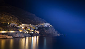 Livadia, Tilos Island, Greece at night. Port illuminated at night in Livadia on Tilos Island, Greece royalty free stock photography
