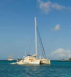 A live-aboard catamaran anchored in the grenadines Stock Image