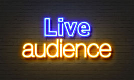 Live audience neon sign on brick wall background. Live audience neon sign on brick wall background Stock Photos