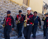 Live band waling down the street Royalty Free Stock Photos