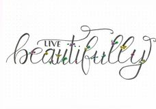 `Live beautifully` hand lettering with flourishing and colorful flowers royalty free illustration