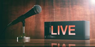 LIVE on a black box and a microphone on a wooden desk. 3d illustration. LIVE written on a black box and a microphone on a wooden desk. 3d illustration Stock Image