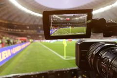 Live broadcast of a football match. The view through the camera screen Stock Image
