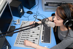 Live broadcasting. A radio DJ announces news in a studio Royalty Free Stock Photo