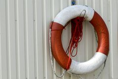 Live buoy. Is hanging in the harbor stock photography