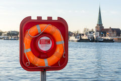 Live buoy at the ferry port Stock Image