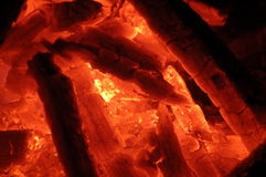 Live coal. Glowing coals in a barbecue grill royalty free stock photography